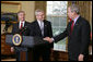 "President George W. Bush shakes the hand of Josh Bolten Tuesday, March 28, 2006, after introducing him as the new Chief of Staff, succeeding Secretary Andrew Card. "" No person is better prepared for this important position, and I'm honored that Josh has agreed to serve,"" said the President.  White House photo by David Bohrer"