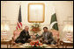 President George W. Bush is welcomed by Pakistan President Pervez Musharraf to Aiwan-e-Sadr in Islamabad, Pakistan, Saturday, March 4, 2006. White House photo by Eric Draper