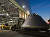 The simulated Orion crew module heads to its temporary home in a hangar at NASA's Langley Research Center