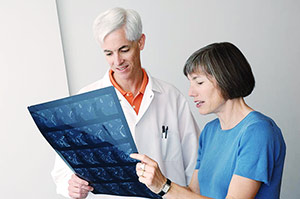 Dr. Griffith and Anne Madeo examine a CT scan.