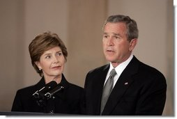 President George W. Bush gives remarks on the death of Pope John Paul II with First Lady Mrs. Laura Bush at the White House on Saturday April 2, 2005.  White House photo by Paul Morse