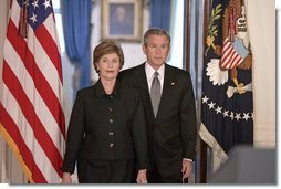 President George W. Bush and Mrs. Laura Bush walk into the Cross Hall prior to the President giving remarks on the death of Pope John Paul II at the White House on Saturday April 2, 2005.  White House photo by Paul Morse