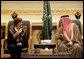 After arriving in Riyadh, Tuesday, Oct. 23, 2007, Mrs. Laura Bush talks with Prince Faisal Bin Abdallah Bin Abd al-Aziz Al Saud, President of the Saudi Cancer Society and President of the Saudi Red Crescent Society. White House photo by Shealah Craighead