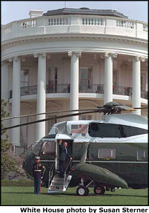 George W. Bush waves goodbye as he leaves for the Summit of the Americas in Quebec, Canada.