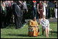 Mrs. Laura Bush and Ghana's first lady Theresa Kufuor sit together on the South Lawn of the White House during the South Lawn Arrival Ceremony Monday, Sept. 15, 2008, on the South Lawn of the White House. White House photo by Chris Greenberg