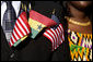 Flags of the United States and Ghana are displayed by a guest attending the South Lawn Arrival Ceremony for President John Agyekum Kufuor of Ghana Monday, Sept. 15, 2008, at the White House. White House photo by David Bohrer