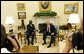 President George W. Bush and President John Agyekum Kufuor of Ghana pause for photos in the Oval Office prior to their meeting Monday, Sept. 15, 2008, at the White House. White House photo by Joyce N. Boghosian