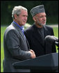 President George W. Bush and Afghanistan President Hamid Karzai shake hands following their address to the media at a joint press availability Monday Aug. 6, 2007, at Camp David near Thurmont, Md. White House photo by Eric Draper