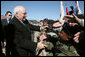 Vice President Dick Cheney shakes the outstretched hands of soldiers Tuesday, Feb. 26, 2008, following a rally for the troops at Fort Hood, Texas, home of the U.S. Army's First Cavalry Division. White House photo by David Bohrer