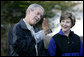 President George W. Bush and Mrs. Laura Bush have a close look at a screech owl Saturday, Oct. 20, 2007 at the Patuxent Research Refuge in Laurel, Md., where President Bush discussed steps his Administration is creating for a series of cooperative conservation steps to preserve and restore critical stopover habitat for migratory birds in the United States. White House photo by Eric Draper