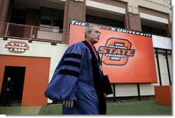 President George W. Bush walks onto the field of Boone Pickens Stadium at Oklahoma State University in Stillwater, OK where he delivered the commencement address to the class of 2006 on Saturday May 6, 2006.  White House photo by Paul Morse