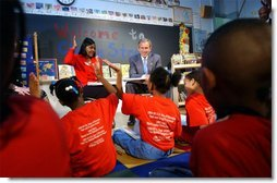 "President George W. Bush visits with teacher Carolyn Davis and her students at Clarke Street Elementary School in Milwaukee, Wis., Wednesday, May 8. ""I'm here because this is a great school that believes every child can learn,"" said President Bush who listened to the students demonstrate their reading drills. During his talk with the children, the President emphasized the importance of reading over watching television. White House photo by Tina Hager."