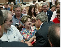 President George W. Bush greets the residents of Fort Smith, Ark., before heading back to Washington, D.C., Tuesday, May 11, 2004.  White House photo by Paul Morse
