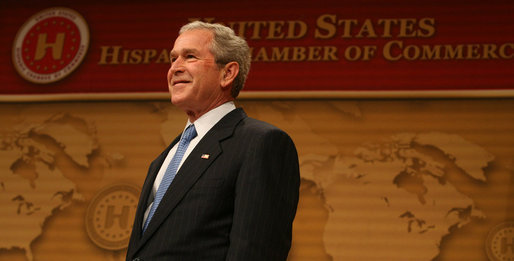 President George W. Bush smiles as he's introduced Wednesday, March 12, 2008, onstage at the Ronald Reagan Building and International Trade Center where he spoke to the United States' Hispanic Chamber of Commerce. The USHCC is the most influential Hispanic business organization in the United States, communicating the needs of Hispanic enterprise to corporate America and the Federal government. White House photo by Joyce N. Boghosian