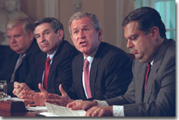 President George W. Bush speaks to reporters during an Energy Meeting in Cabinet Room Thursday, May 3, flanked by Energy Secretary Spencer Abraham, right, and Deputy Defense Secretary Paul Wolfowitz WHITE HOUSE PHOTO BY ERIC DRAPER