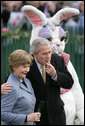 President George W. Bush embraces Mrs. Laura Bush as he blows a whistle Monday, March 24, 2008 on the South Lawn of the White House, to officially start the festivities for the 2008 White House Easter Egg Roll.  White House photo by Chris Greenberg