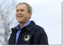 """President George W. Bush smiles during his introduction before delivering remarks on Earth Day at Wells National Estuarine Research Reserve in Wells, Maine, Thursday, April 22, 2004. """"The importance about Earth Day is that it reminds us that we can't take the natural wonders for granted. That's what Earth Day says to me, and I hope it says to you, as well, that we have responsibilities to the natural world to conserve that which we have and to make it even better,"""" said the President in his remarks.  White House photo by Eric Draper"""