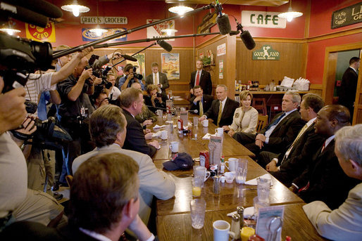 President George W. Bush talks with members of the media during his breakfast meeting with community leaders at the Corner Cafe in Riverside, Mo., Wednesday, Aug. 22, 2007. White House photo by Chris Greenberg