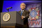 """President George W. Bush, delivering his remarks Wednesday, Aug. 22, 2007, to the Veterans of Foreign Wars National Convention in Kansas City, Mo., said """"So long as we remain true to our ideals, we will defeat the extremists in Iraq and Afghanistan."""" White House photo by Chris Greenberg"""