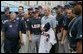 President George W. Bush poses for a photo with the U.S. Olympic men's baseball team and their manager Davey Johnson, right, prior to a practice game with the Chinese Olympic men's baseball team Monday Aug. 11, 2008, at the 2008 Summer Olympic Games in Beijing. The U.S. Olympic men's baseball team presented President Bush with a U.S. Olympic baseball hat and an autographed U.S. Olympic baseball jersey. White House photo by Chris Greenberg