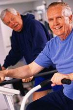 Older men on exercise bikes