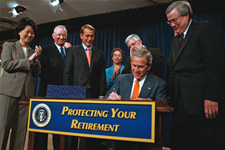 Image of President Bush signing the Pension Protection Act of 2006 on August 17th
