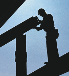 Image of a man working on steel beems up in the air