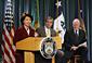 Secretary Chao, Commerce Secretary Carlos M. Gutierrez (center), and Treasury Secretary John W. Snow (right).