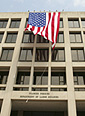 Image of American flag flying from the U.S. Department of Labor building.