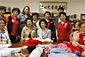 Secretary Chao meets with volunteers and families doing crafts at the Chinese Community Center in Houston.