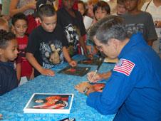 Bob Cabana signs autographs