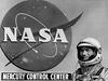 Mercury astronaut Scott Carpenter stands in front of the Mercury Control Center.