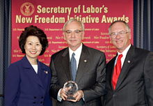 Secretary of Labor Elaine L. Chao (L) and Assistant Secretary of Labor for Disability Employment Policy Roy Grizzard (R) present a 2004 Secretary of Labor's New Freedom Initiative Award to James Wells (center) Vice ChairmanSunTrust Banks, Inc.