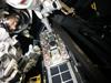 Astronaut Andrew Feustel practices installing the Fastener Capture Plate