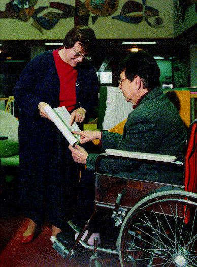 Library staff assisting patron