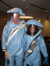 Photo students in lab suits