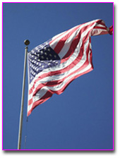 United States flag on a pole blowing in the wind