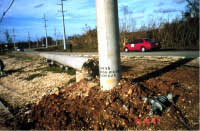 Base of newly replaced concrete power pole