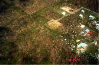 Debris scattered near single-family dwellings