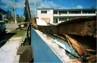 Unreinforced masonry wall building demolished by wind, note inadequate anchorage