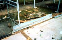 Concrete floor slab of school building blown apart by wind: note lack of base connectors