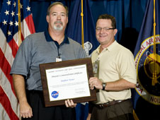 Stephen Turner receives the Director's Commendation from Marshall Center Director David King
