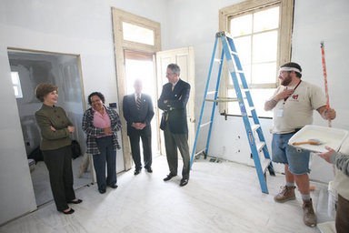 Mrs. Laura Bush is joined by homeowner Joretta Roman as she views the renovation project at Roman's home Thursday, October 30, 2008, in New Orleans, La., during a tour of the home being rennovated by Catholic Charities Operation Helping Hands. The home sustained damage during Hurricane Katrina. White House photo by Chris Greenberg