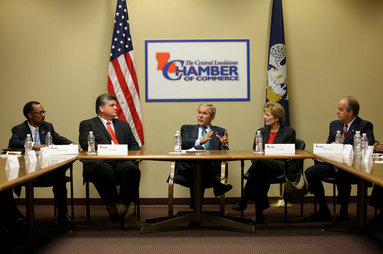 President George W. Bush gestures as he participates in a roundtable meeting on the economy with local business leaders from Alexandria, Louisiana Monday, Oct. 20, 2008, at the Central Louisiana Chamber of Commerce in Alexandria, Louisiana. The President delivered a statement on the Emergency Economic Stabilization Act and the Department of the Treasury's Troubled Asset Relief Plan. Joining the President from left to right, Martin Johnson, Lance Harris, Grace Allen, and Blake Chatelain. White House photo by Chris Greenberg