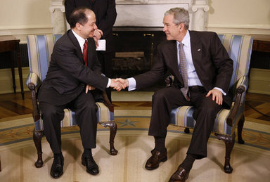 President George W. Bush welcomes Kurdistan Regional Government President Massoud Barzani to the Oval Office, Wednesday, Oct. 29, 2008, at the White House. White House photo by Eric Draper