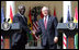 President George W. Bush shakes hands with President John Agyekum Kufuor of Ghana following a joint statement Monday, Sept. 15, 2008, in the Rose Garden of the White House.