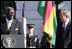 President George W. Bush smiles as President John Agyekum Kufuor of Ghana delivers remarks Monday, Sept. 15, 2008, during the South Lawn Arrival Ceremony for President Kufuor and Mrs. Theresa Kufuor of Ghana on the South Lawn of the White House.