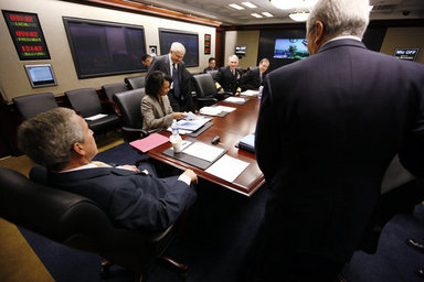 President George W. Bush is seen at a National Security Council meeting in the White House Situation Room Monday, March 24, 2008, during a video teleconference with General David Petraeus, Commander of the Multi-National Force-Iraq; and Ryan Crocker, U.S. Ambassador to Iraq. White House photo by Eric Draper