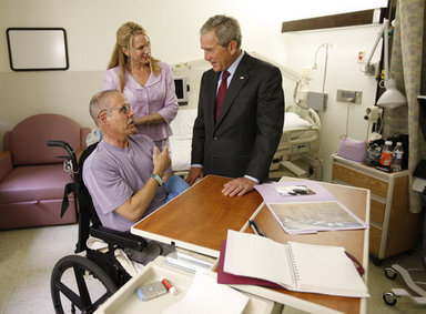 President George W. Bush talks with U.S. Army Brig. Gen. Dr. Charles William Fox, Jr. (Retired) and wife, Jan, of Leesburg, Va. during a visit Tuesday, Sept. 9, 2008, with wounded military personnel at Walter Reed Army Medical Center, in Washington, D.C. General Fox, CEO of Project Hope, was injured by an IED while helping to build a state-of-the-art cancer treatment facility for children in Basra. White House photo by Eric Draper