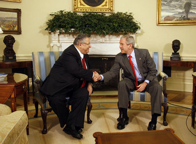 """President George W. Bush shakes hands with Jalal Talabani, President of Iraq, during a meeting Wednesday, June 25, 2008, in the Oval Office at the White House. President Bush said, """"It's been my honor to welcome a friend, President Talabani, back to the Oval Office. He is the President of a free Iraq. He is a man who's been on the front lines of helping to unify Iraq and to help Iraq recover from a brutal regime -- that of Saddam Hussein."""" White House photo by Eric Draper"""